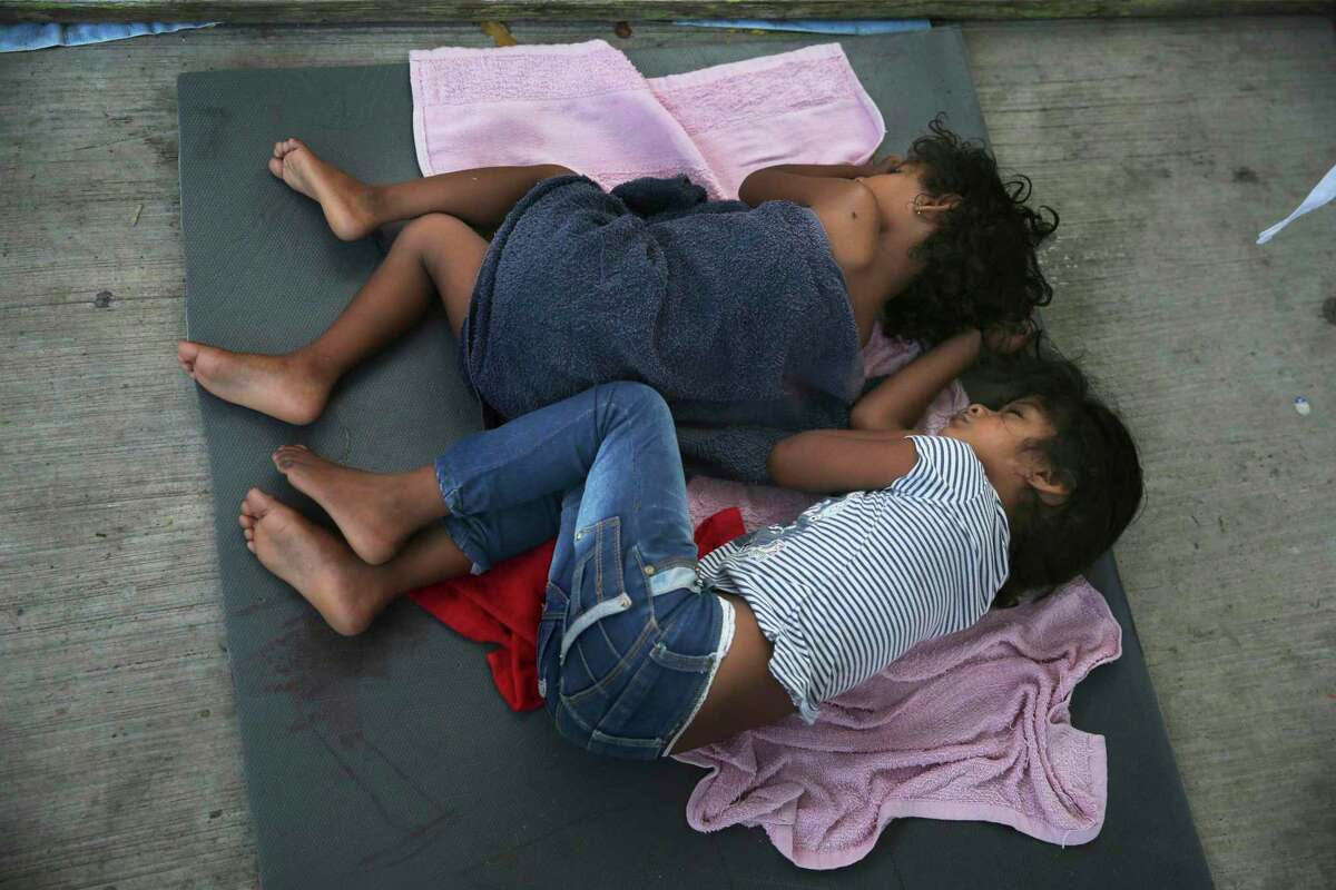 In this July 17, 2019 file photo, migrant children sleep on a mattress on the floor of the AMAR migrant shelter in Nuevo Laredo, Mexico. The Trump administration is now fast-tracking the legal proceedings of thousands of immigrant children in its care, including unveiling a pilot program in Houston to stream their hearings through video technology - a move advocates say will jeopardize their asylum cases and speed up deportations.