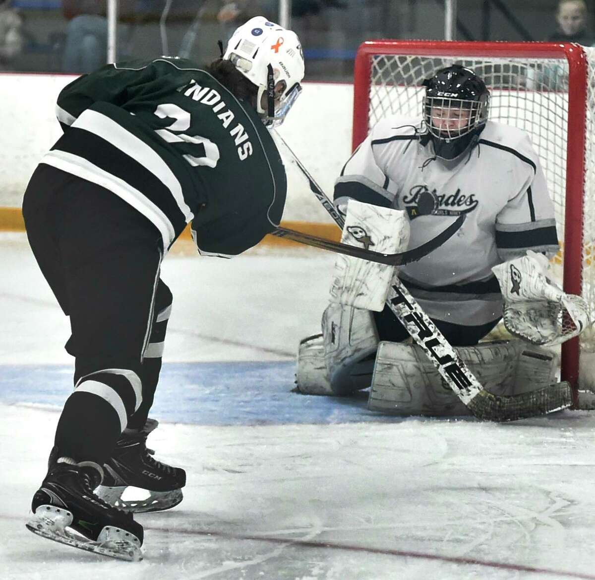 Guilford's Maddie Epke takes a shot on goal against goalie Jude Krukar of Amity-New Haven- Cheshire Blades, right, goal during the second period of the SCC championship on Saturday at Bennett Rink in West Haven.