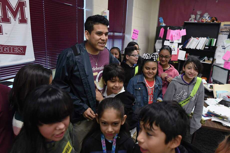 """Gerardo Villegas Juarez, fifth-grade math teacher at Graebner Elementary School, gathers his students after being named a finalist in the 2020 H-E-B Excellence in Education Awards on Wednesday. """"Their energy, when they understand, this is what drives me,"""" he said. """"I want to be the model of having a good attitude and what that does."""" Photo: Billy Calzada /Staff Photographer / ***MANDATORY CREDIT FOR PHOTOG AND SAN ANTONIO EXPRESS-NEWS /NO SALES/MAGS OUT/TV"""