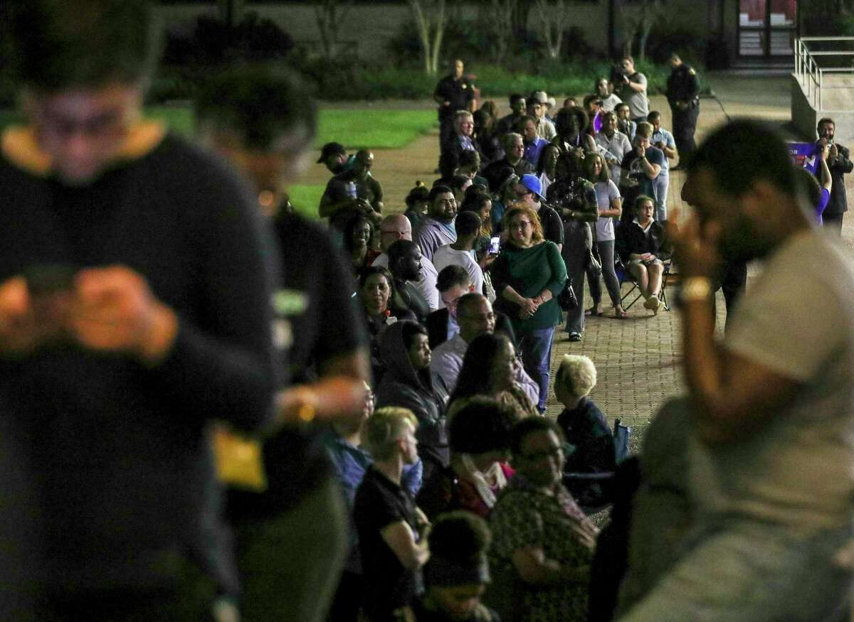 People wait in line to vote Tuesday, March 3, 2020, at Texas Southern University in Houston. (Jon Shapley/Houston Chronicle via AP)