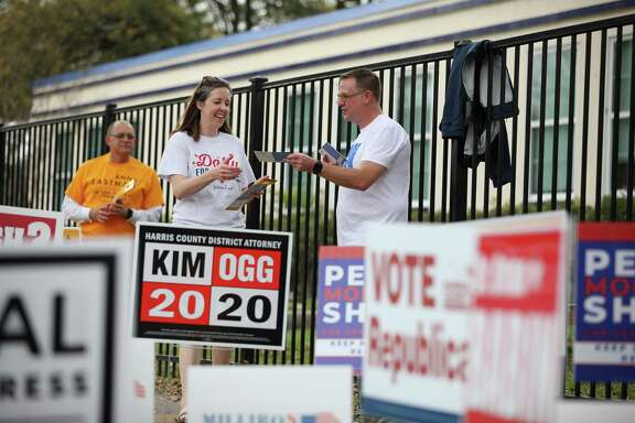 Volunteers hand out campaign pamphlets outside a polling station on election day last week.