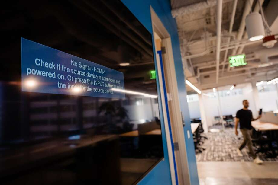 "A large TV monitor is displays a ""disconnected"" message at the new offices of Metromile in San Francisco, Calif. on Wednesday, March 4, 2020. Metromile has had a hard outfitting some of the communication aspects of their new offices as a result of the Coronoavirus. Photo: Nick Otto / Special To The Chronicle"