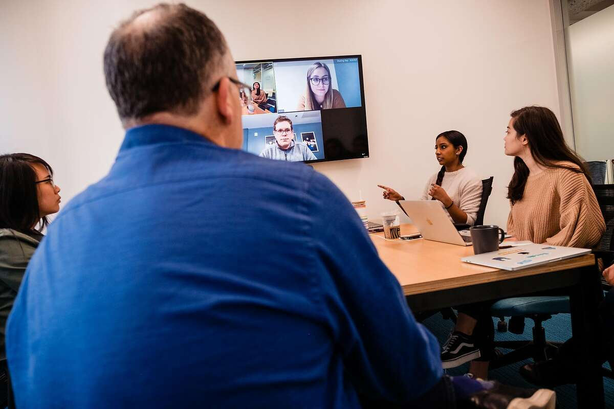 Metromile employees hold a meeting in a video conference room at the new offices of Metromile in San Francisco, Calif. on Wednesday, March 4, 2020. Metromile has had a hard outfitting some of the communication aspects of their new offices as a result of the Coronoavirus.