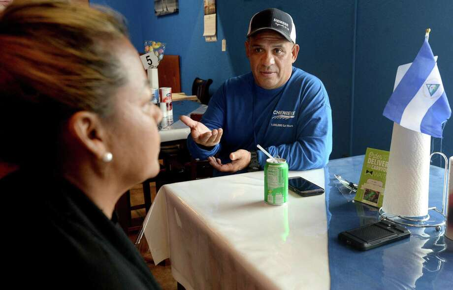 Miguel Perez and Amada Perez Moody talk over a point while sharing their thoughts on the presidential primary results from Super Tuesday while having lunch at Nicarauguan Caribbean Cafe in Port Arthur Wednesday. Photo taken Wednesday, March 4, 2020 Kim Brent/The Enterprise Photo: Kim Brent / The Enterprise / BEN