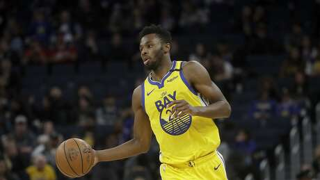 Golden State Warriors guard Andrew Wiggins (22) against the Washington Wizards during an NBA basketball game in San Francisco, Sunday, March 1, 2020. (AP Photo/Jeff Chiu)