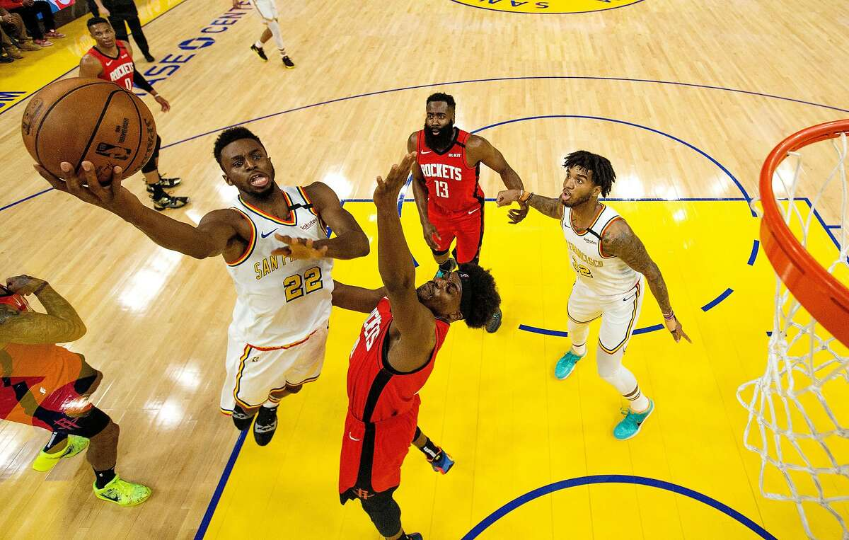 Andrew Wiggins (22) puts up a shot over Danuel House Jr., (4) in the first half as the Golden State Warriors played the Houston Rockets at Chase Center in San Francisco, Calif., on Thursday, February 20, 2020.