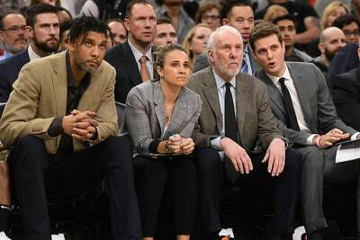San Antonio Spurs head coach Gregg Popovich, second from right, and assistants Tim Duncan, left, Becky Hammon and Will Hardy watch as the Spurs fall to the Indiana Pacers in the AT&T Center on Monday, March 2, 2020.