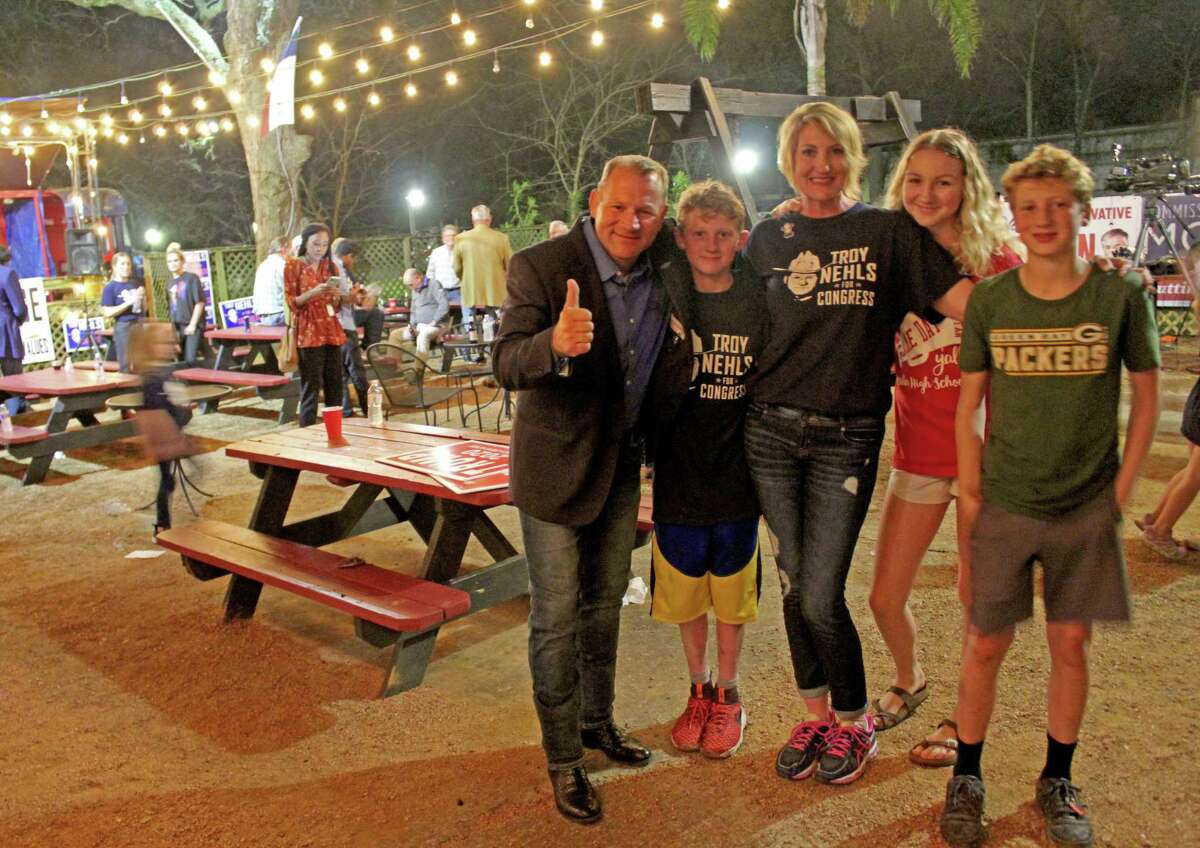 Fort Bend County Sheriff Troy Nehls (left) and his sister-in-law Keri Nehls (center) celebrate at an election watch party on March 3, 2020. Pictured from left: Troy Nehls, Wyatt Nehls, Kerri Nehls, Madison Nehls, Parker Nehls