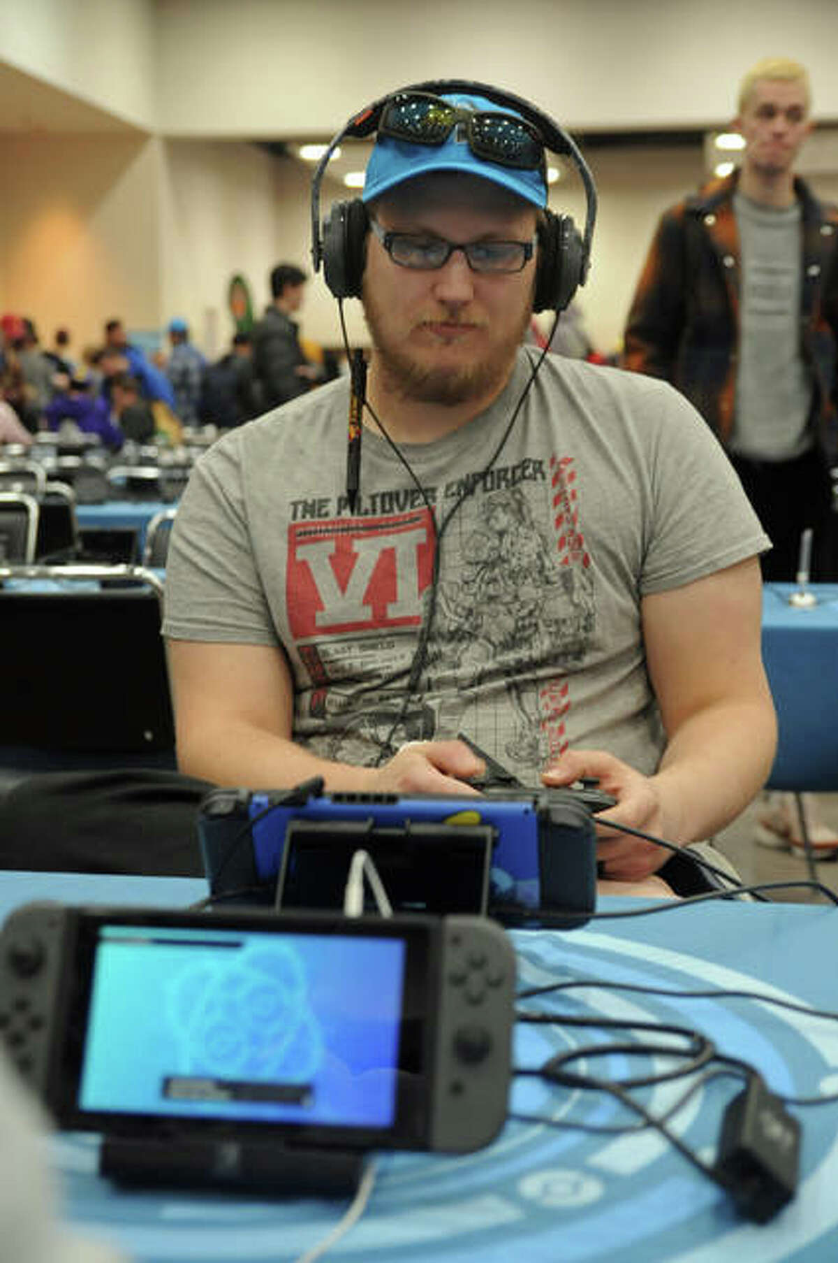 Carl Wilken, of Warrensburg, Missouri, competes during the Pokémon Regional Championship over the weekend in Collinsville. More than 1,200 people gathered in one large room to play video games Saturday at Gateway Center.