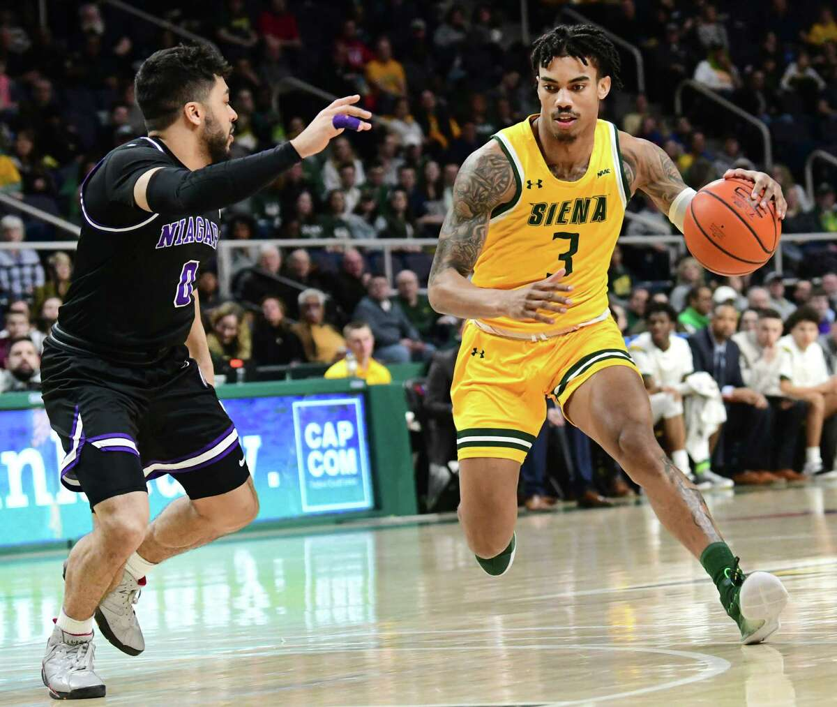 Siena's Manny Camper drives to the basket during a game at Times Union Center last season. He announced on Wednesday that he has withdrawn from the NBA draft and will return to the Saints for his senior season. (Lori Van Buren/Times Union)