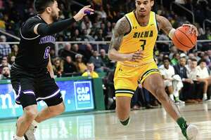 Siena's Manny Camper drives to the basket against Justin Roberts during a game at the Times Union Center on Wednesday, March 4, 2020 in Albany, N.Y. (Lori Van Buren/Times Union)