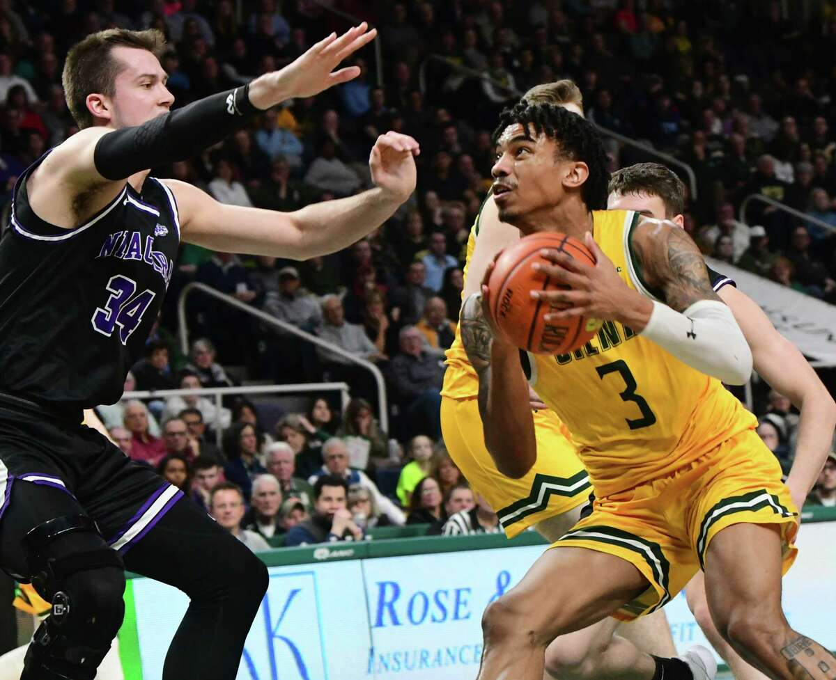 Siena's Manny Camper drives to the basket during a game against Niagara at Times Union Center last season. He announced on Wednesday that he has withdrawn from the NBA draft and will return to the Saints for his senior season. (Lori Van Buren/Times Union)