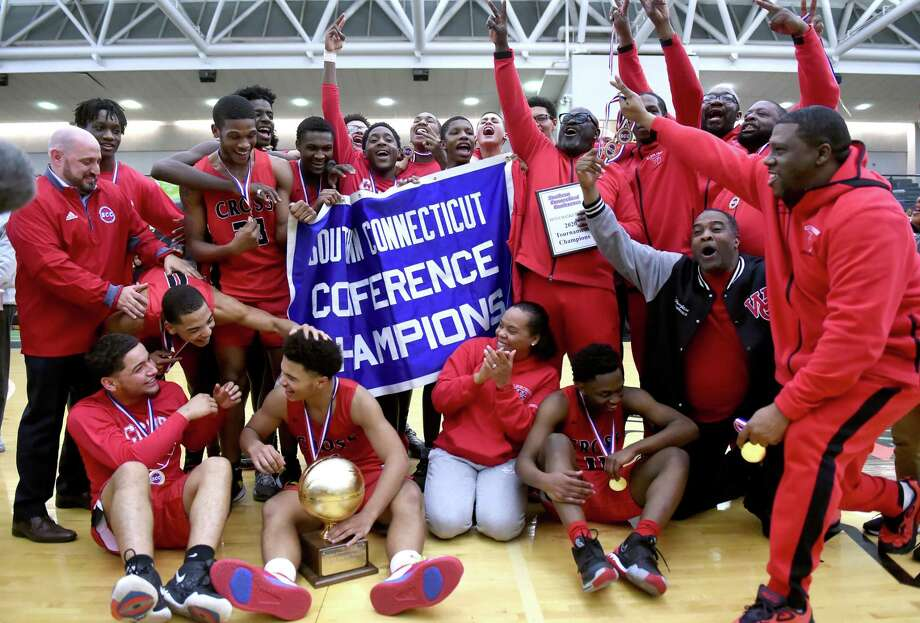 Wilbur Cross celebrates its 49-48 win over Notre Dame-West Haven in the SCC championship game at the Floyd Little Athletic Center on Wednesday. Photo: Arnold Gold / Hearst Connecticut Media / New Haven Register