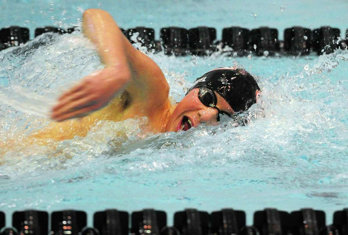Cheshire's Justin Finkel competes in the 400 yard freestyle relay race during SCC Boys Swimming Championship action at Southern Connecticut State University in New Haven, Conn., on Wednesday Mar. 4, 2020.
