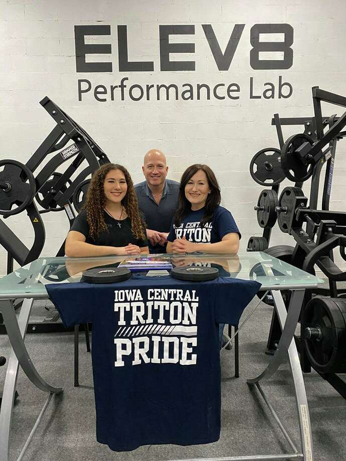 Daejia Rodriguez, left, was joined by her uncle John Rodriguez and her mother Laurie Rodriguez as she signed her National Letter of Intent to play volleyball at Iowa Central. Photo: Courtesy Photo
