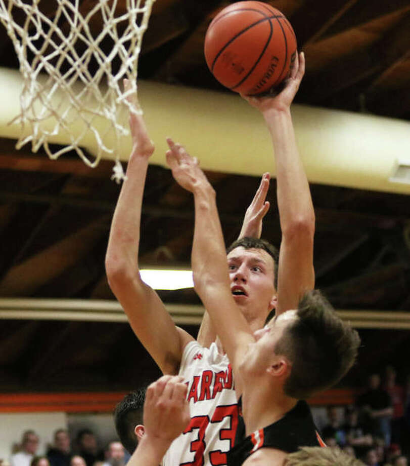 Calhoun's Corey Nelson (33) shoots over a Raymond Lincolnwood defender during Friday's championship game at the Lincolnwood Class 1A Regional in Raymond. On Wednesday night at Dupo, the Warriors' season ended with a loss to Winchester West Central. Photo: Greg Shashack / The Telegraph