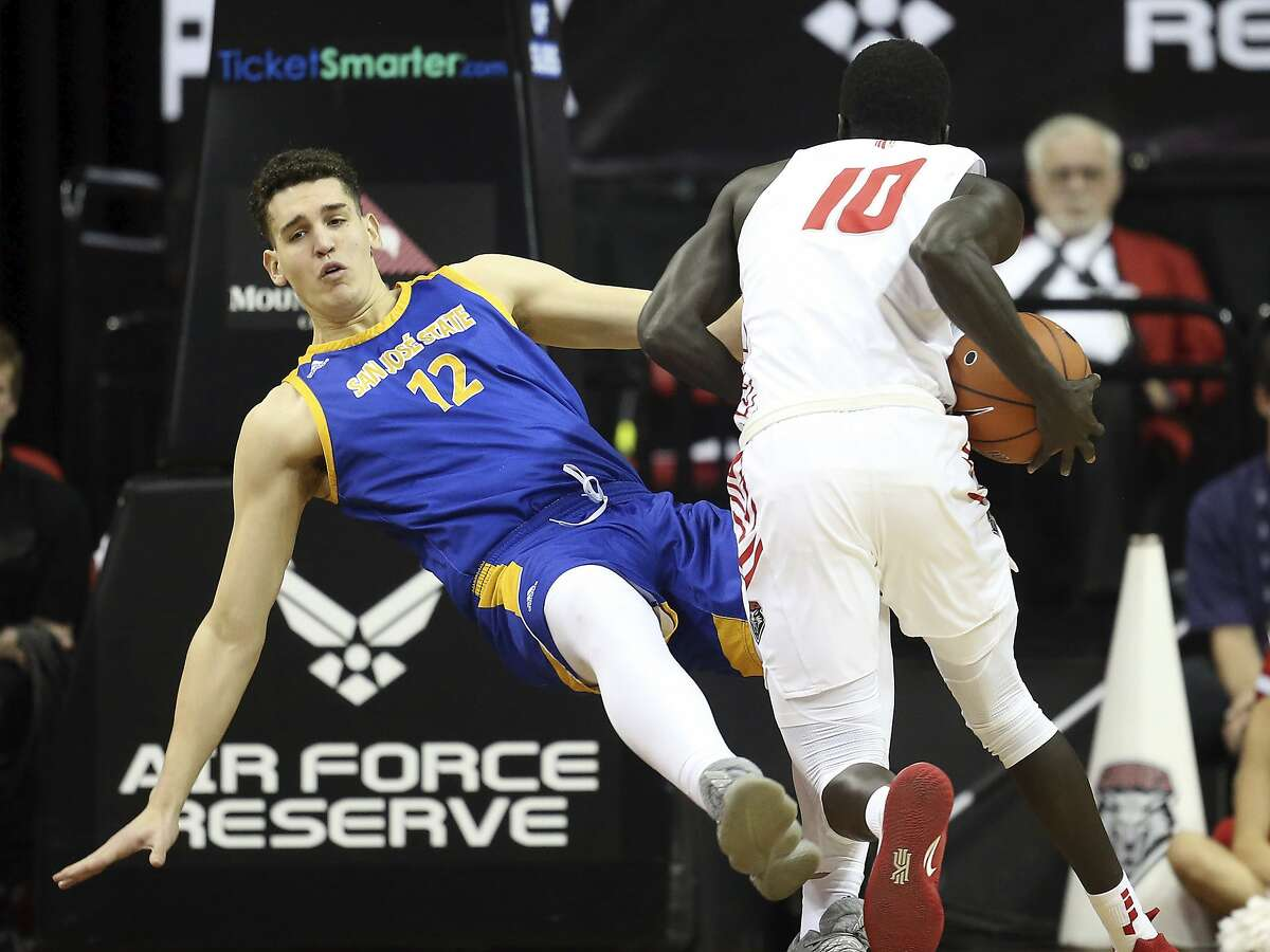 New Mexico's Makuach Maluach (10) is called for an offensive foul against San Jose State's Eduardo Lane (12) during the second half of a Mountain West Conference tournament NCAA college basketball game Wednesday, March 4, 2020, in Las Vegas. (AP Photo/Isaac Brekken)