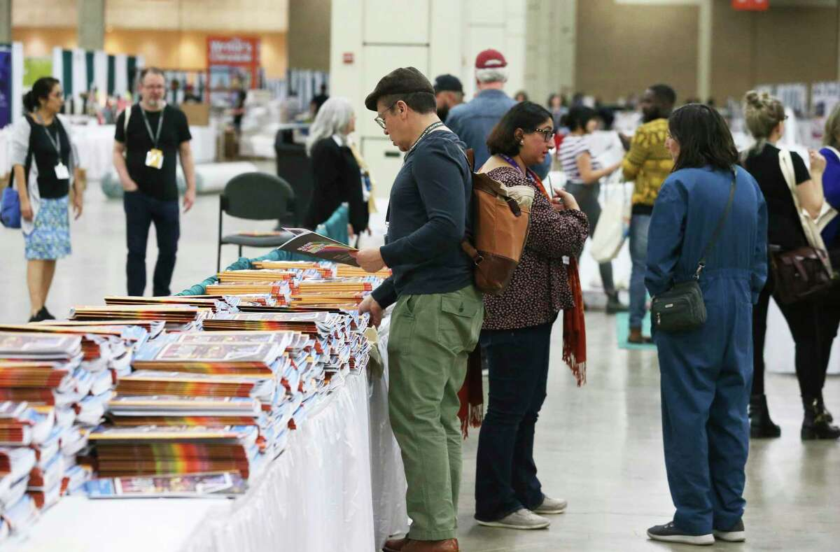 Participants sign up and prepare exhibits at the Association of Writers & Writing Programs Conference and Bookfair at the Henry B. Gonzalez Convention Center on Feb. 4.