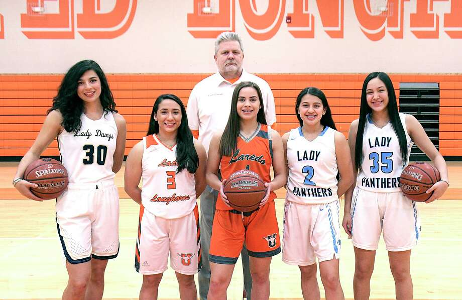 UISD swept the top honors in the all-district awards with United's Frank Gonzalez (Coach of the Year) joined by, from left, Alysse Benavides (Defensive Player of the Year), Ariana Garza (Sixth Man of the Year), Evelyn Quiroz (Most Valuable Player), Angelina Lopez (Offensive Player of the Year) and Rebecca Hernandez (Newcomer of the Year). Photo: Cuate Santos /Laredo Morning Times / Laredo Morning Times