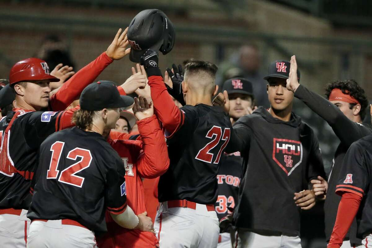Houston's Rey Mendoza (27) celebrates scoring the 6th run with the dugout during a baseball game against Rice at Rice Wednesday, Mar. 4, 2020 in Houston, TX.