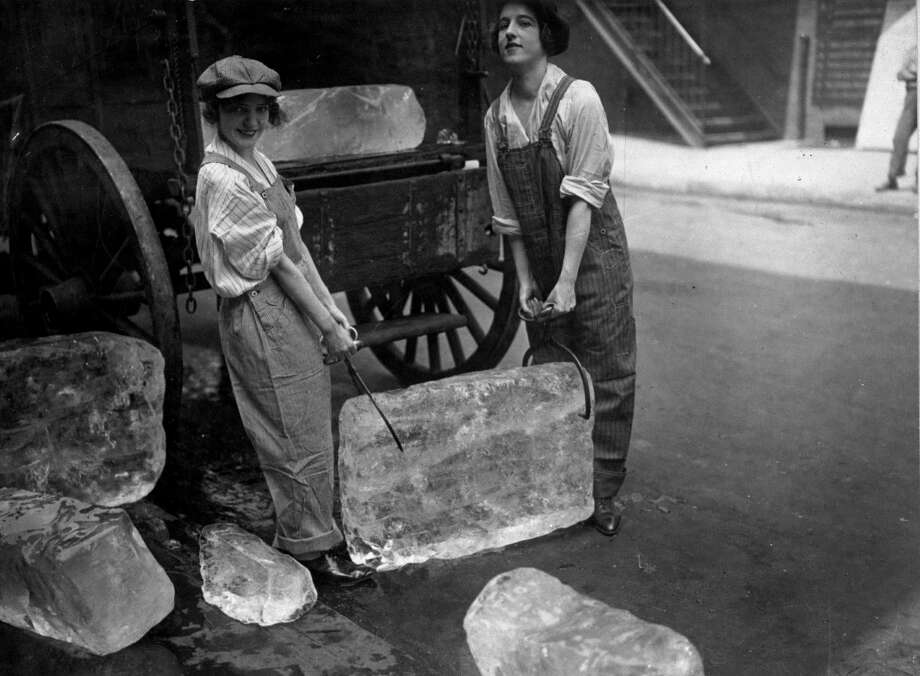 """Girls deliver ice in this photo from theSmithsonian traveling exhibition, """"The Way We Worked,"""" which has made a stopat the Castle Museum of Saginaw County History.(Photo provided/Castle Museum)"""