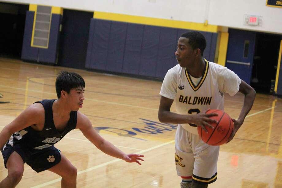 Baldwin's Carmelo Lindsey eyes his next move against the Brethren defense on Friday. (Star photo/John Raffel)