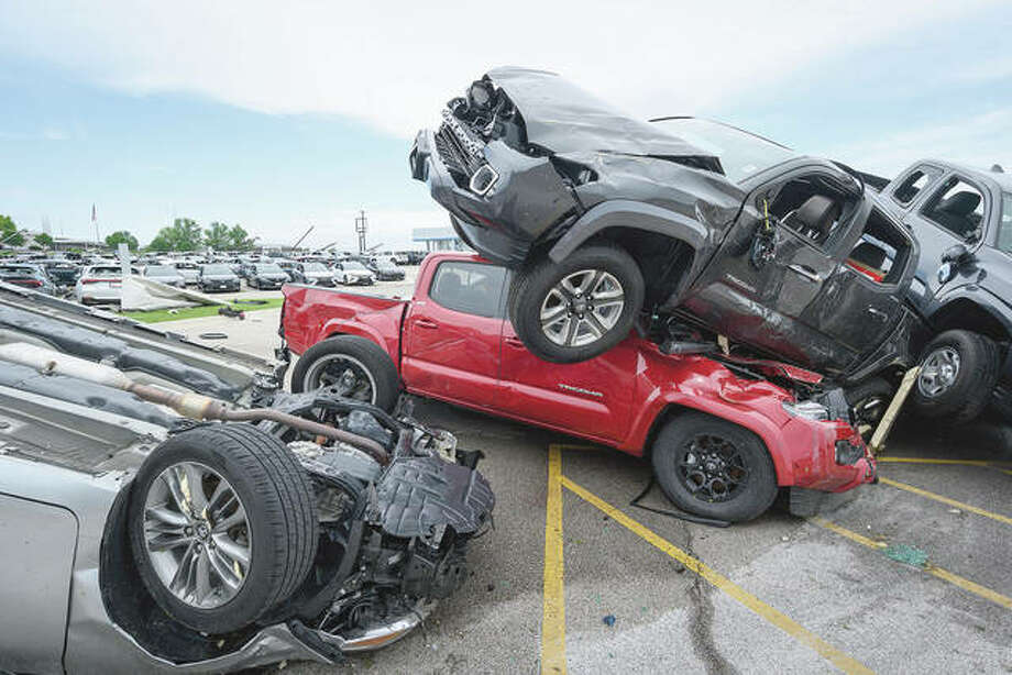 Trucks are piled on top of each other at Riley Auto Group on May 23 in Jefferson City, Missouri, after a tornado struck there. A series of powerful tornadoes killed at least three people in southwestern Missouri, causing extensive damage in Jefferson City. Photo: Reed Hoffmann | Getty Images