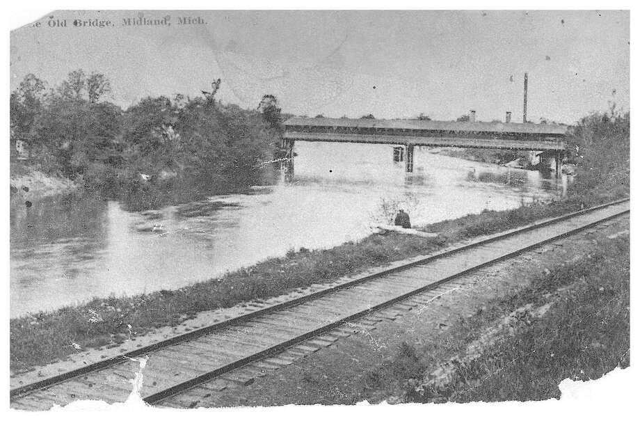 This is a photo of the Benson Street Covered Bridge from a post card by Will P. Conaan, Grand Rapids, for George C. Thompson of Midland. Notice the pier in the middle of the bridge, which was destroyed by ice dams during the flood of 1907. (Photo provided)