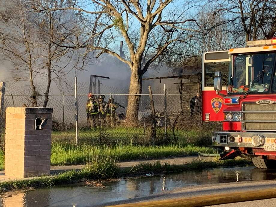 San Antonio firefighters were called to the 6400 block of Macrum Drive after a home was completely engulfed in flames Thursday morning. Photo: Taylor Pettaway