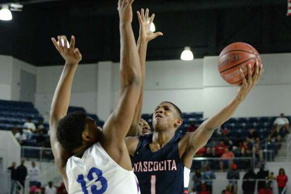 Kaleb Stewart (1) of Atascocita attempts a shot past Patrick Williams (13) of Dickinson during the fourth quarter of the Boys 6A Region III Quarterfinal basketball game between the Dickinson Gators and the Atascocita Eagles on Tuesday, March 3, 2020 at Delmar Fieldhouse, Houston, TX.