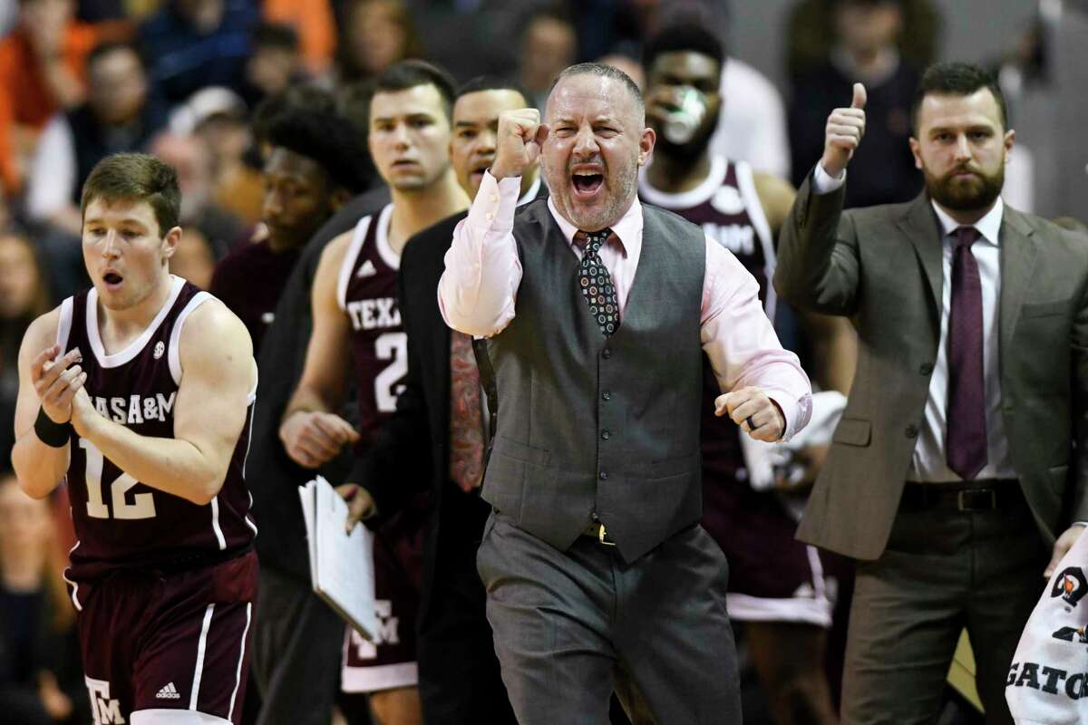 Texas A&M head coach Buzz Williams celebrates a score to tie Auburn during the first half of an NCAA college basketball game Wednesday, March 4, 2020, in Auburn, Ala. (AP Photo/Julie Bennett)