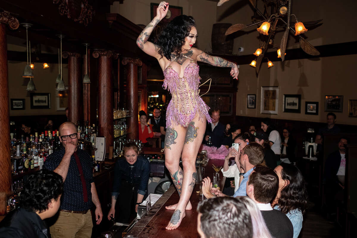 Burlesque dancer, Frankie Fictitious, performs at Comstock Saloon on March 4, 2020.
