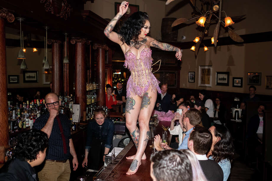 Burlesque dancer, Frankie Fictitious, performs at Comstock Saloon on March 4, 2020. Photo: Alex Nicholson