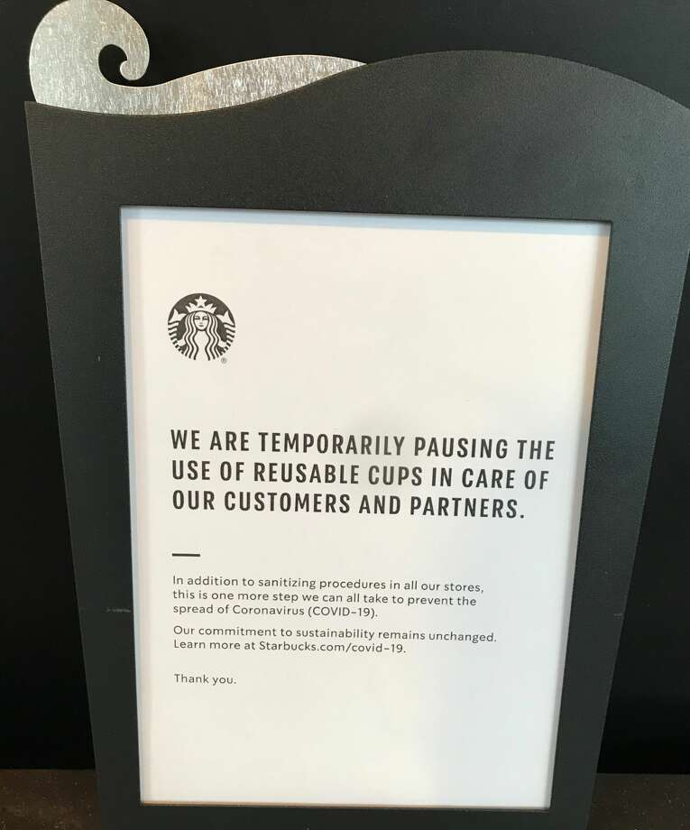 Many coffee lovers around the country were greeted by this sign this morning, pictured at the Lower Queen Anne storefront, as the Seattle-based coffee giant has suspended its reusable cup program amid COVID-19 concerns. Photo: Callie Craighead, SeattlePI