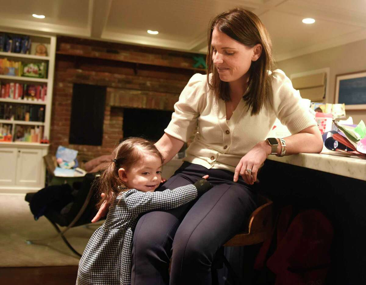 Elodie Kubik, 3, hugs her mother, Emily Kubik, at their Riverside home on Tuesday. Elodie was born with a rare genetic condition called epidermolysis bullosa, which causes fragile skin that can be wounded and break open during normal daily activities. The life expectancy for those with Elodie's type of EB is just 30 years. The family has an annual fundraiser, the Plunge For Elodie, and for the first time, they're hosting a plunge in Old Greenwich at Lucas Point Beach on March 8 at 8 a.m. There will be other plunges that same weekend in Boston, San Francisco, London and Staten Island with a goal of raising $250,000.