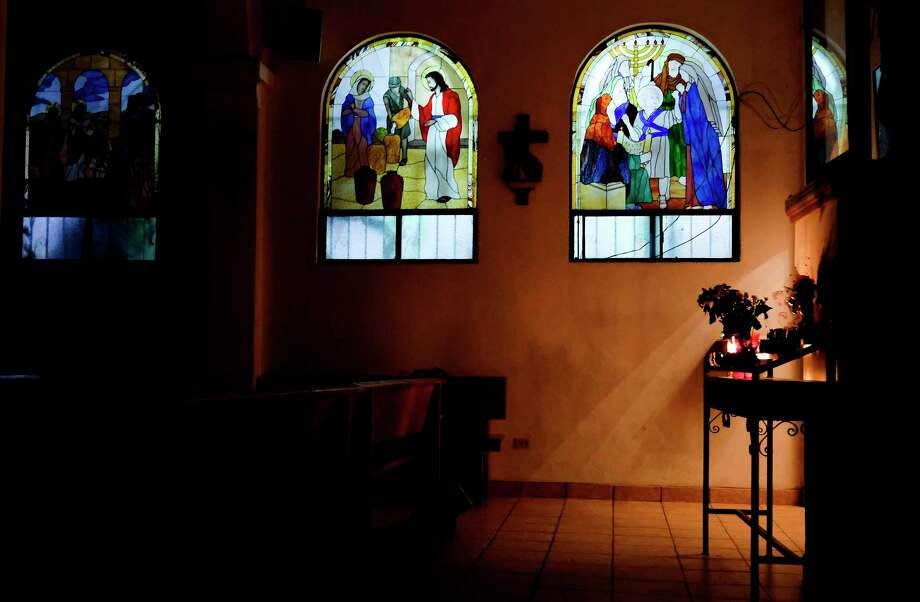 Painted glass windows let in some evening light at Our Lady of the Incarnation in the Camino Verde neighborhood of Tijuana on Nov. 9, 2019. Photo: Elizabeth Conley, Staff Photographer / © 2020 Houston Chronicle USE ONLY IN International Priests article March 2020 and social media associated with this article. Thi