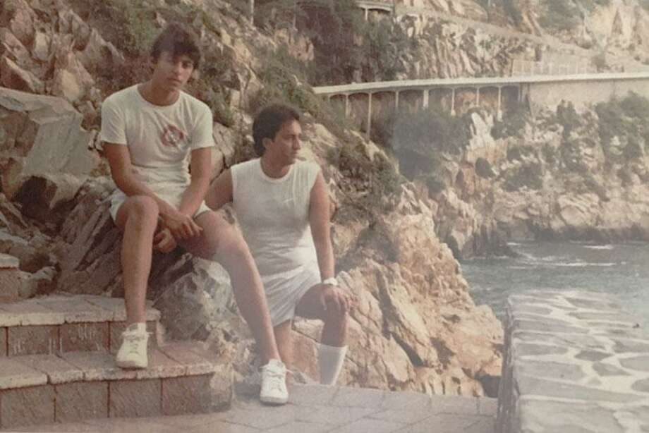 A photograph of Torres, left, and Pinal on vacation in Mexico from a photo album at Pinal's home shown to and photographed by a reporter.