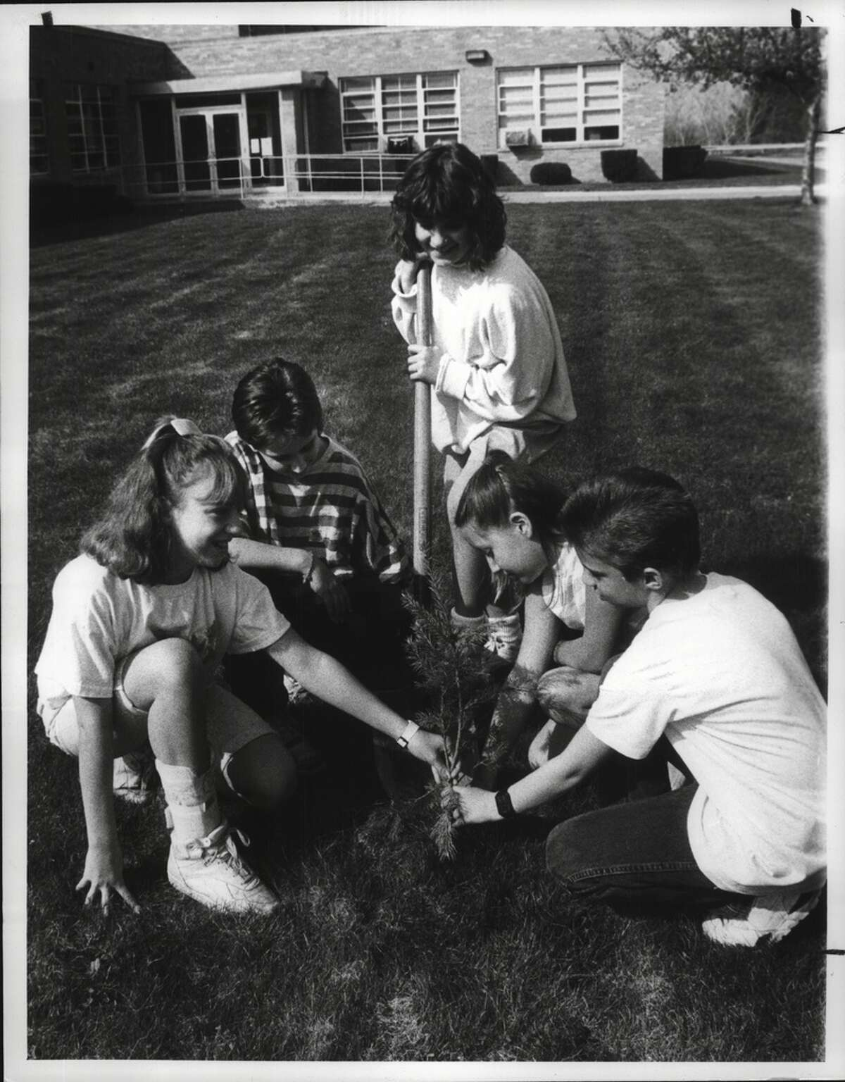 Gardner Dickinson School, Wynanskill, New York - Amanda Decetise; Mike Wasula; Melissa Millington; Ann Marie Lanesey; Jeremy Navarette - 5th grade students planting trees for Earth Day. The school planted a total of 30 trees. Each grade planted trees. April 26, 1990 (Arnold LeFevre/Times Union Archive)