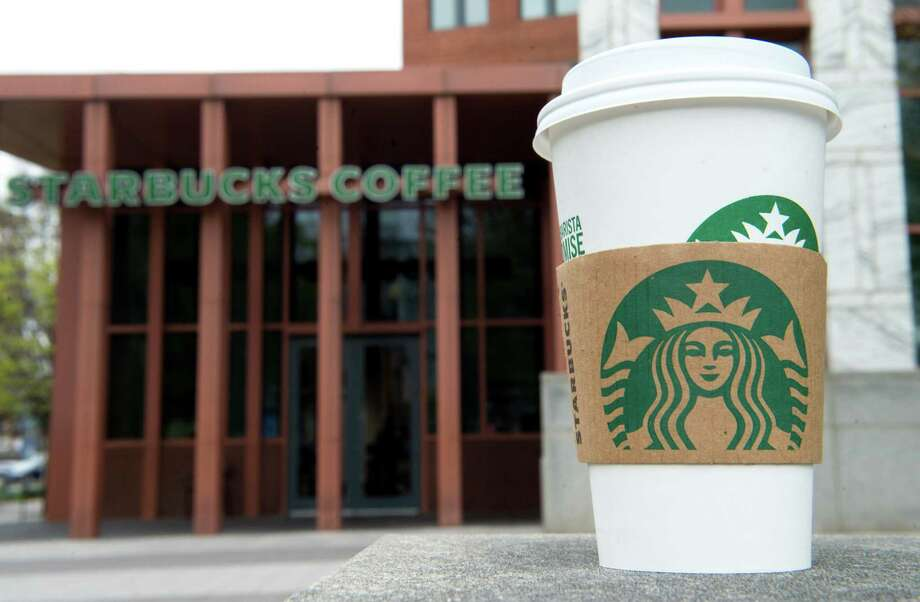 In this file photo taken a Starbucks coffee cup is seen outside a Starbucks Coffee shop in Washington, D.C. in April 2018. Reusable cups are in vogue for reducing waste but are no longer welcome at Starbucks cafes over fears of the coronavirus, the coffee chain announced. Photo: SAUL LOEB / AFP Via Getty Images / AFP or licensors