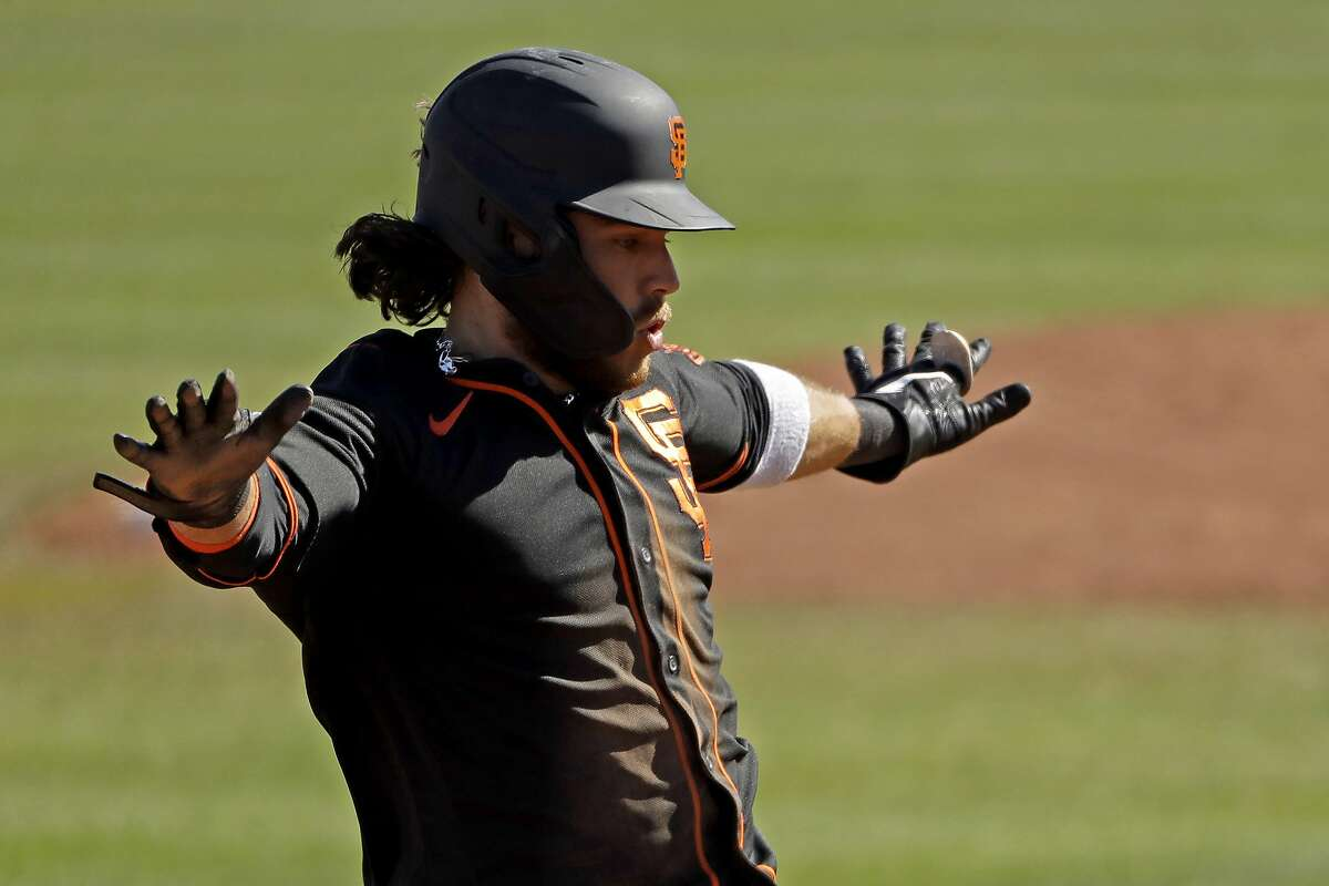 San Francisco Giants' Brandon Crawford steals a base during the fifth inning of a spring training baseball game against the San Diego Padres Sunday, March 1, 2020, in Peoria, Ariz. (AP Photo/Charlie Riedel)