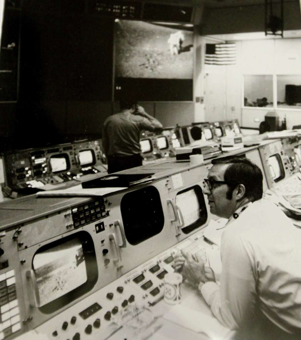 This undated photo, part of of Moody Medical Library's Charles A. Berry, M.D. Space Medicine Collection in Galveston, Texas, shows Dr. Charles A. Berry in Mission Control at NASA in Houston. (Moody Medical Library's Charles A. Berry, M.D. Space Medicine Collection/The Galveston County Daily News via AP)