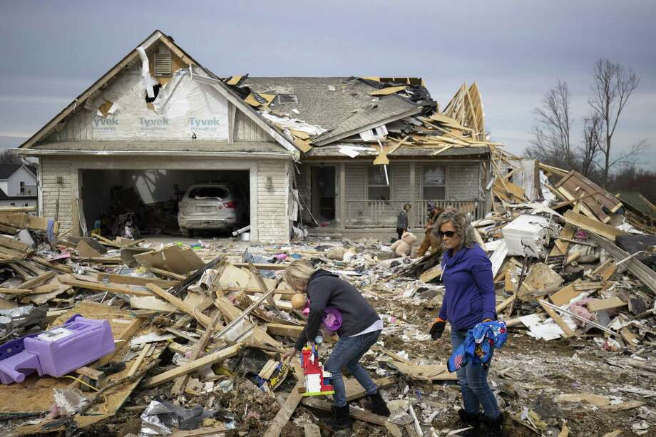 Families sort through tornado debris to gather possessions on March 4, 2020 in Cookeville, Tennessee. A tornado passed through the Nashville area early Tuesday morning which left Putnam County with 18 killed and 38 unaccounted for. Stamford-based nonprofit Americares has responded to the tornadoes in Tennessee by delivering medicine and relief supplies to affected communities. Photo: Brett Carlsen / Getty Images / 2020 Getty Images