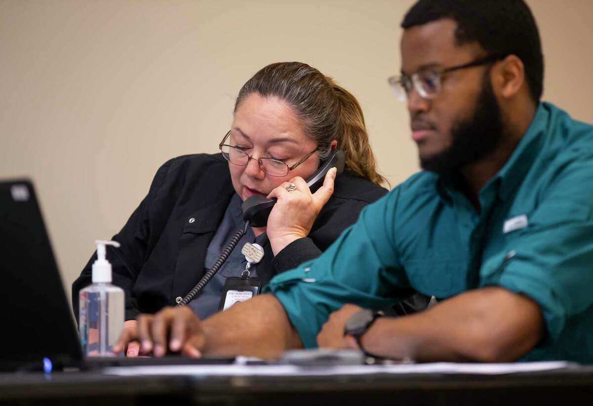 Fort Bend County health care professionals answer calls from the public and health care providers inside a call center Thursday, March 5, 2020, at the Fort Bend County annex in Rosenberg. Callers are asked a series of questions to see if they are eligible for a coronavirus screening test.
