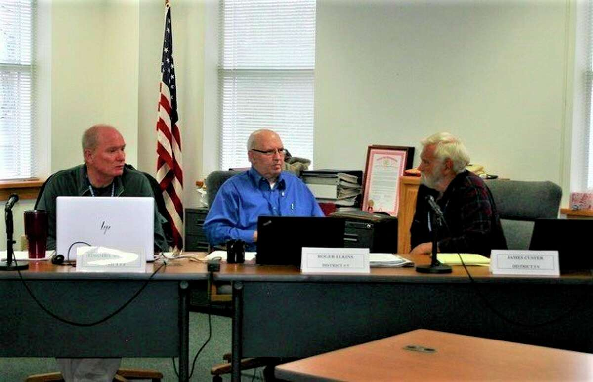 Commissioners debate the pros and cons of renovating the newly purchased property on Upton Avenue to accommodate an EMS training room. Previous discussions involved leasing a suite from the Health Department and renovating it to be used asa training room. (Herald Review photo/Cathie Crew)