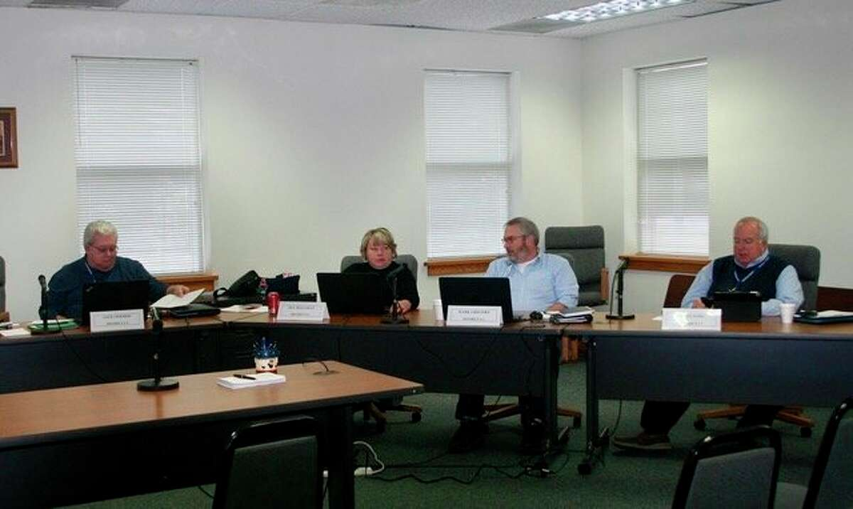 The Osceola County Commissioners discuss the possibility of using the property on Upton Avenue for the EMS training room. The county expects to close on the property in the next week. (Herald Review photo/Cathie Crew)