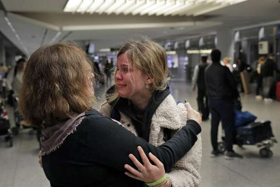 Connie Emerson hugs her tearful daughter, Sophie after she arrived following a 20-hour travel day at San Francisco International Airport in San Francisco, Calif., on Wednesday, March 4, 2020. Emerson had been on a semester abroad in Italy when San Diego State cut short the program out of fear of the Covid-19 virus infections in the country.