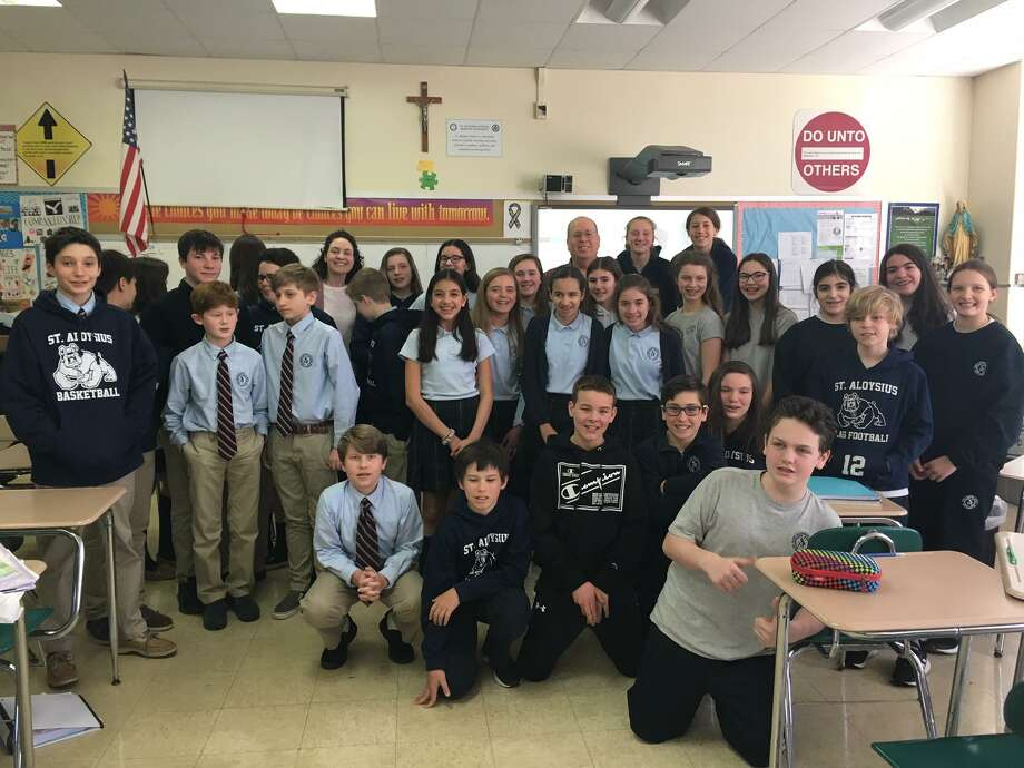 Seventh and eighth grade classes at St. Aloysius School in New Canaan visit with Town Players of New Canaan 'Rocket Girl' playwright George D. Morgan and Sally Rose Zuckert following one of their performances. Photo: Contributed Photo