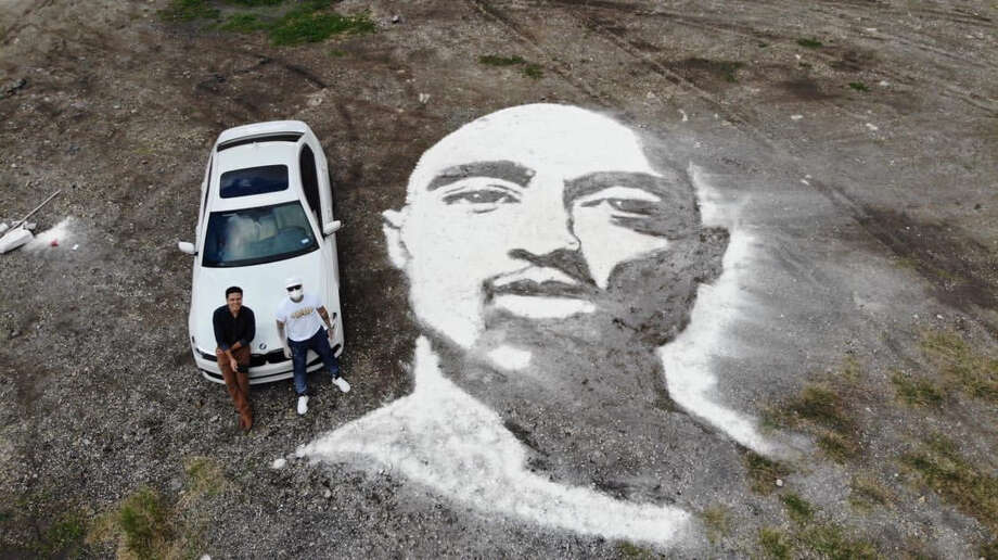 """A massive powder portrait of rapper Tupac covers a patch of land near downtown San Antonio and proves yet again that Rob """"The Original"""" Ferrel can create art anywhere, using anything. Photo: Courtesy, Gabriel Chavez Of Skyline Drone"""