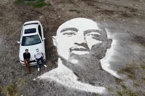 """A massive powder portrait of rapper Tupac covers a patch of land near downtown San Antonio and proves yet again that Rob """"The Original"""" Ferrel can create art anywhere, using anything."""