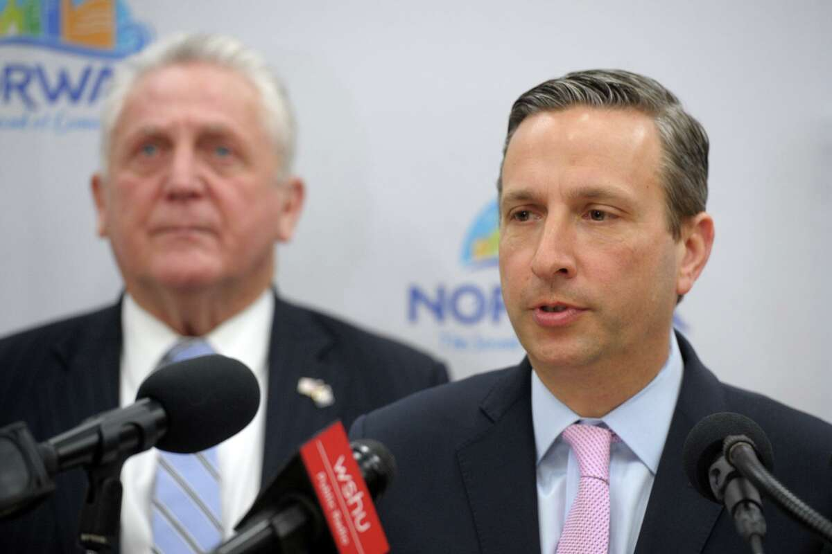 State Sen. Bob Duff, right, speaks during a news conference at City Hall in Norwalk March 5 about plans to monitor the coronavirus. Norwalk Mayor Harry Rilling is to the left.